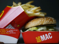 A Big Mac hamburger and french fries are pictured in a McDonalds fast food store in Central London on August 6, 2008. McDonald's launched a campaign on August 6 to recruit 4,000 staff in Britain to satisfy the demand from cash-strapped customers flocking to its restaurants as the credit crunch bites hard. As the rest of the British economy hits turbulent times, the fast food giant said it was serving an extra two million meals a month compared with this time last year. AFP PHOTO/Ben Stansall